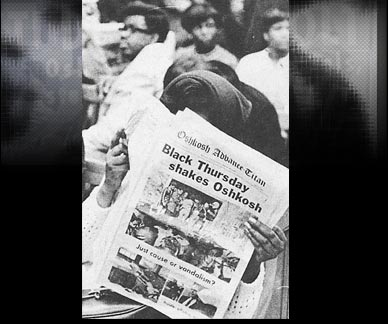 Woman Reading newspaper about Black Thrusday in Oshkosh
